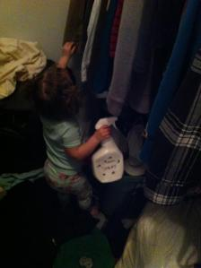 Spraying our closet for monsters with her Monster Spray