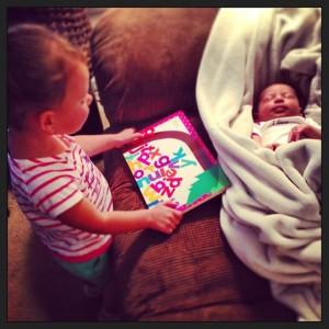 Sophia reading to Maddie while Maddie sleeps.